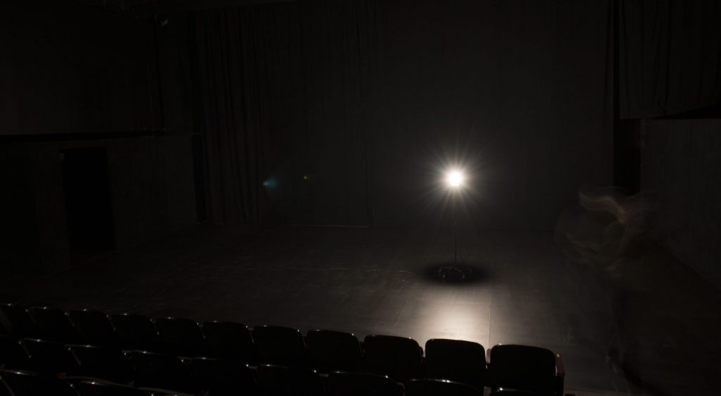 a light bulb on a bare stage